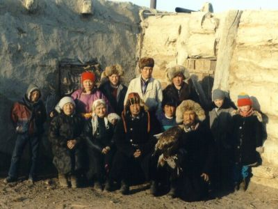 With eagle hunter's family - early 2000's photo