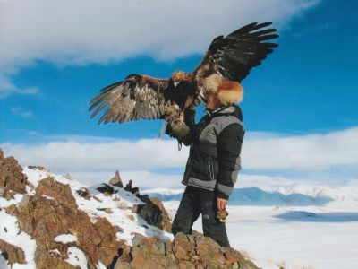 Eagle hunter with his golden eagle